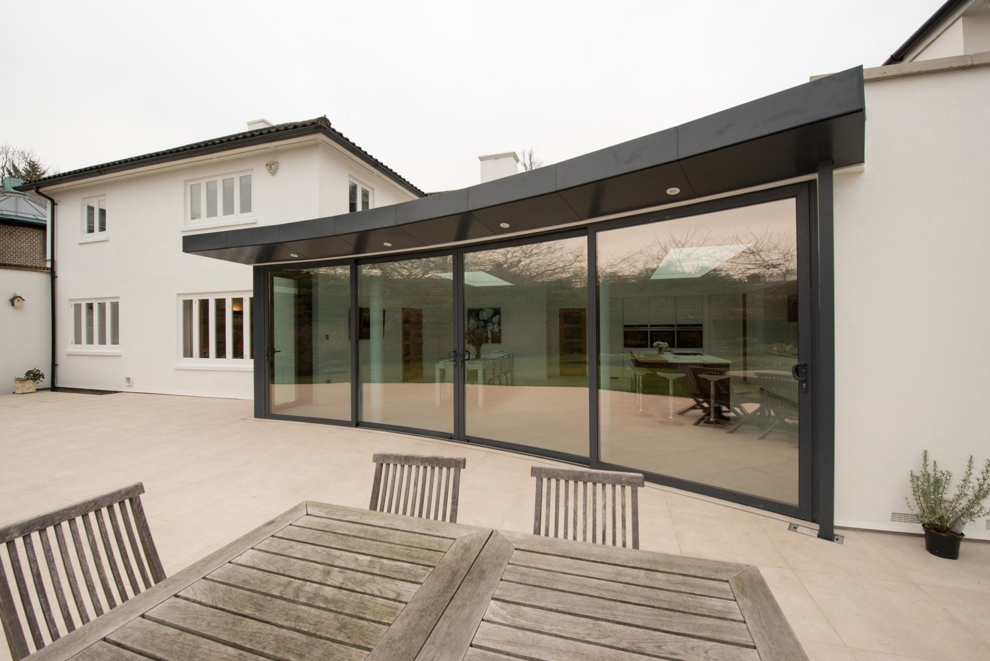 Ground floor extension with curved patio doors and green roof in Dulwich, London